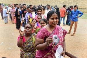 People queue up to cast their ballot during the polling day for the Karnataka Assembly election 2018 in Bengaluru on Saturday.
