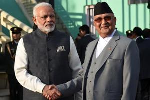 Nepali Prime Minister KP Sharma Oli greets Indian Prime Minister Narendra Modi during a guard of honour in Kathmandu on May 11.