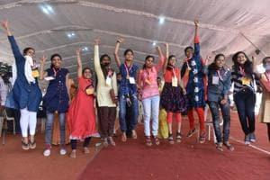 Meritorious students pose for a group photo after declaration of MP Board result 2018 in Bhopal.