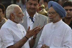 Prime Minister Narendra Modi talks to former PM Manmohan Singh during Dusshera celebration at Lal Quila Grounds in New Delhi in September 2017.