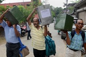 Polling officials leave for poll-duty on the eve of the panchayat elections, in North 24 Parganas on Sunday.