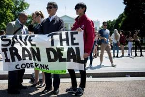 Protesters stand outside the White House in Washington, DC  on May 8, as US President Donald Trump announces the United State