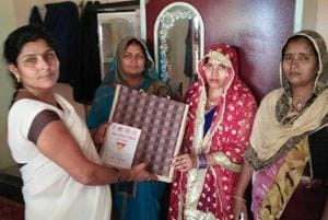 An Asha worker gifts 'shagun' to a newlywed on behalf of the UPgovernment. The gift is part of Nai Pahal Scheme under the National Health Mission.