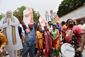 BJP workers with the cut-outs of PM Narendra Modi and party president Amit Shah on May 15, New Delhi