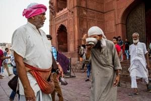 Muhammad Jamil offers a bowl of ice-cold water to a devotee outside Jama Masjid in Old Delhi.