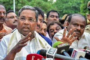 Outgoing Karnataka chief minister Siddaramaiah and JD(S) president HD Kumaraswamy address the media after a meeting with governor Rudabhai Vala in Bengaluru on May 15.