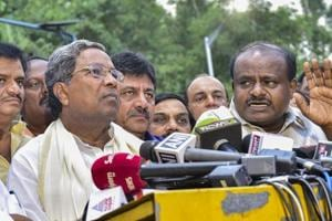 Outgoing Karnataka chief minister Siddaramaiah and JD(S) president HD Kumaraswamy address media after a meeting with governor Rudabhai Vala in Bengaluru.
