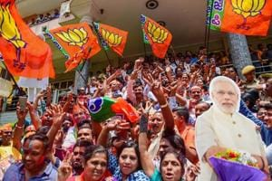BJP workers celebrate the party