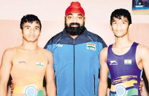 Maharashtra wrestlers Atul Chechar(left) and Saurabh Igave with their coach Ranveer Singh Rahal(centre).
