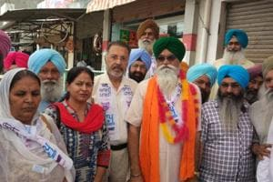 AAP candidate for Shahkot bypoll , Rattan Singh Kakkar with party supporters during his campaign at Shahkot on Wednesday.