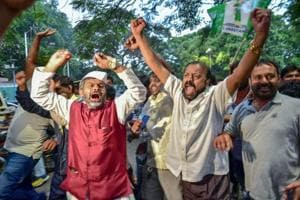 JD(S) workers celebrate after Congress offered the chief minister's post to its president Kumaraswamy.