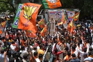 Bharatiya Janata Party supporters celebrate outside the BJP office after the Karnataka poll result in Bengaluru on Tuesday.