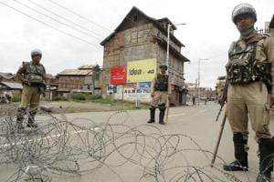 Paramilitary soldiers stand guard during restriction in downtown area of Srinagar.
