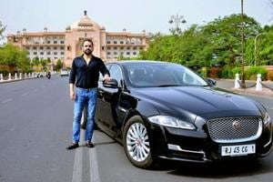 Rrahul Tanejaa with his Jaguar with premium number 1.