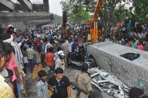 Police and rescue personnel gather at the scene of a flyover collapse in Varanasi on Tuesday.