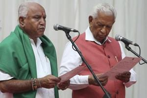 Karnataka state Governor Vajubhai Vala, right, administers oath to Bharatiya Janata Party (BJP) leader B. S. Yeddyurappa, left, as Chief Minister of the state in Bangalore, India, Thursday, May 17, 2018.
