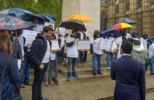 Indian professionals protest against allegedly UK visa rules, outside UK Parliament in London on Wednesday.