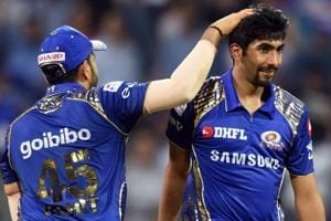 Mumbai Indians skipper Rohit Sharma and bowler Jasprit Bumrah celebrate the wicket of Kings XI Punjab batsman Aaron Finch during the IPL 2018 match on Wednesday.