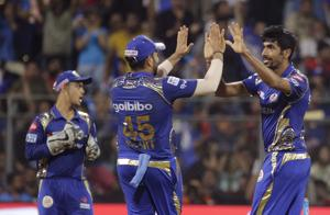 Mumbai Indians' Jasprit Bumrah, right, celebrate the dismissal of King XI Punjab