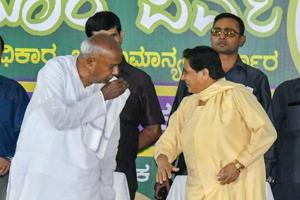 BSP chief Mayawati interacts with former Prime Minister HD Deve Gowda during a campaign for Karnataka Assembly Elections in Mysore.
