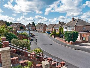 Of passion in English suburbia: A street in a suburb of Birmingham, UK.