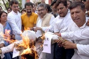 State Congress president Sachin Pilot and supporters burn an effigy of PM Narendra Modi in Jaipur on Thursday.