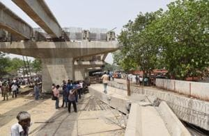 People gather at the site where an under-construction flyover collapsed in Varanasi on  May 16.
