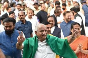BJP leader B S Yeddyurappa flashes the victory sign as he arrives at Governor's House to take oath as Chief Minister of Karnataka state, in Bengaluru, on Thursday.