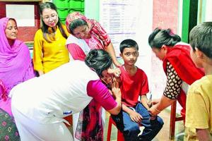 Nassir Hussain, 12, gets vaccinated against measles and rubella on May 12 at a primary health centre in Kwakta, Bishnupur district. The vaccination drive had to be extended in Manipur because of high refusals among Muslims following fake news.