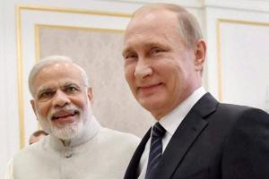 Prime Minister Narendra Modi shakes hands with Russian President Vladimir Putin during a bilateral meeting in Tashkent.