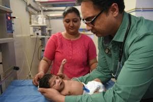 Dr Tejwir Singh Shimar attends to the baby at Mohali civil hospital.