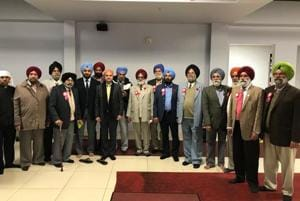India's Consul General Dinesh Bhatia (centre, in orange head covering) at the Dashemesh Darbar gurdwara in Brampton last year during a consular camp there in November.
