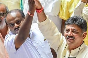 JD(S) leader H D Kumaraswamy with Congress leader D K Shivakumar celebrate after chief minister BS Yediyurappa announced his resignation before the floor test, at Vidhana Soudha, in Bengaluru, on May 19.