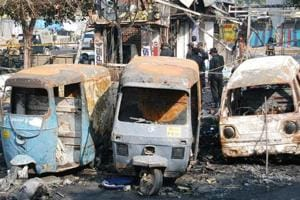 Charred remains of the vehicles damaged in the 2005 blast at New Delhi's Sarojini Nagar. Investigators say Ariz Khan confessed to planting the bomb at the market.