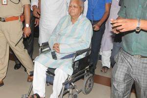 RJD leader Lalu Prasad at Jay Prakash Narayan Airport in Patna on May 16, 2018.