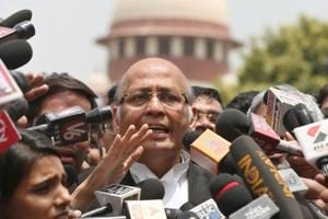 Senior Congress leader and lawyer Abhishek Manu Singhvi speaks to the media after a Supreme Court hearing on the Karnataka issue,  in New Delhi on Friday.