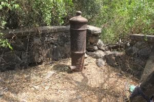 A canon buried upside down at the Kopri creek in Thane.