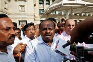 Janata Dal (Secular) leader HD Kumaraswamy (C) speaks to the media outside the legislative house after a vote of confidence motion against the BJP's BS Yeddyurappa government in Bengaluru on Saturday.