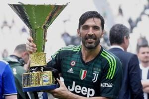 Juventus goalie Gianluigi Buffon holds the Serie A trophy at the Allianz Stadium in Turin, Italy, on Saturday.