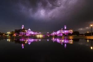 A view of North Block and South Block along with their reflections in the rain water following a thunderstorm in New Delhi on May 13, 2018.