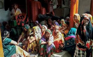 Grieving women in MAdhauli village where six persons died after consuming spurious liquor, in Kanpur Dehat.