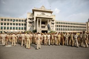 Police personnel maintain vigil outside the Karnataka Vidhana Soudha during a vote of confidence motion against the BS Yeddyurappa