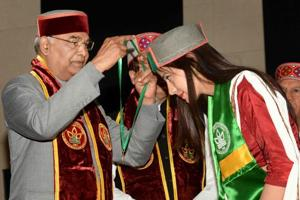 President Ram Nath Kovind presents medal to a student at the 9th convocation of Dr YS Parmar University of Horticulture & Forestry in Solan, Himachal Pradesh on Monday.