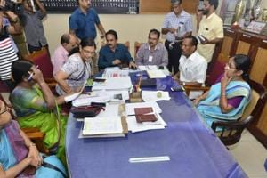 Kerala health minister K K Shailaja (right in blue sari) and state labour minister T P Ramakrishnan holding discussions with health officials in Kozhikode on Monday.