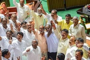 JD(S) leader HD Kumaraswamy and party MLAs show victory sign to celebrate after chief minister BS Yeddyurappa announced his resignation before the floor test, at Vidhana Soudha in Bengaluru.