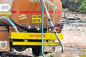 Water tanker illegally fills water from a punctured PMC water tank at Wadgaonsheri.