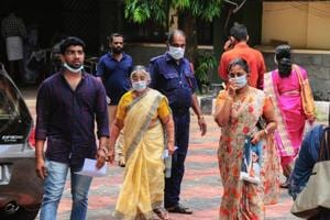 Hospital staff and family members of the patients admitted at the Kozhikode Medical College wear safety masks as a precautionary measure after the