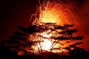 Photos: Hawaii's Kilauea volcano lava reaches Pacific Ocean