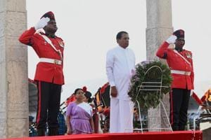 Sri Lankan President Maithripala Sirisena (2R) lays flowers at a memorial for those who died in the decades-long conflict against the Tamil Tigers, during a commemorative ceremony marking the 9th anniversary of the end of the islands Tamil separatist war, in the capital Colombo on May 19, 2018.