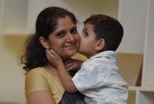 Anu Kumari with her son Viaan at a recent felicitation ceremony in Delhi.